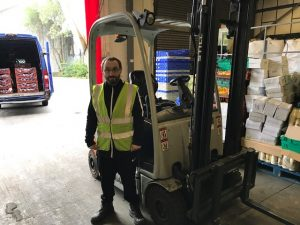 Volunteer with forklift